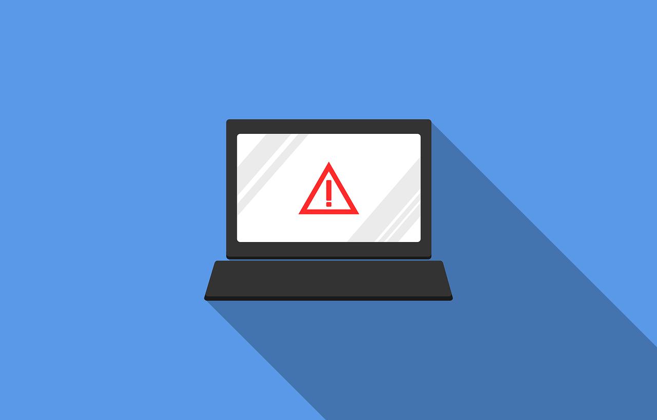 Image of laptop with warning symbol
